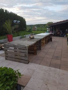 Here we have added some images of the stage when the dining table was in its pretty initial stages, like we can see the rustic touch and dingy texture of the wood pallet dining table. This is a long wood pallet dining table where we have employed a number of whole shipping pallets.