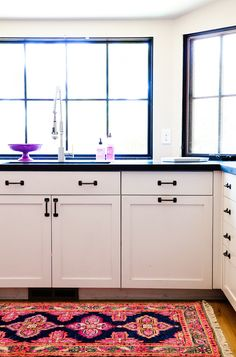 White and black kitchen with purple accents