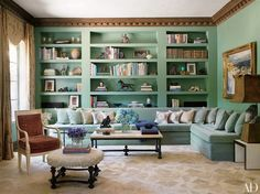 Give your beloved tomes the spotlight they deserve with a splash of bright color on the bookcase, as was done in this 1935 Los Angeles house by Pamela Shamshiri of the interior design firm Commune.