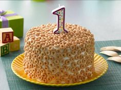 Cheerios®, familiar first food for babies, is a natural fit for a first birthday cake.