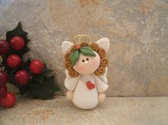A sweet little angel adorned with a tiny red heart. This is an original design that has been handcrafted from polymer clay. The little gal Polymer Clay Ornaments, Polymer Clay Projects, Polymer Clay Creations, Fimo Clay, Angel Crafts, Holiday Crafts, Clay Angel, Polymer Clay Christmas, Clay Figurine