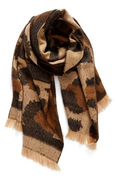 The combo of leopard spots and mixed stripes make this  soft woven scarf the perfect accessory for those chillier days this season.