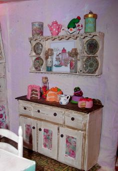 This morning a humble cat food box, this evening an antique dresser and shelves. Hang on to your good cardboard. DIY Doll House