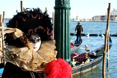 Carnaval in Venice. Everyone in masks, roaming the streets.....how intriguing...