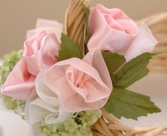 DIY: How to make ribbon roses  Ribbon roses are great to use in gift wrapping, to embellish hats, add to wedding bouquets and chair backs, or to your party favors. They can be used in home decorating, gift wrapping and they make pretty clothing accessories. Wrap the ruffles loosely for an open rose and tightly for a rose bud.