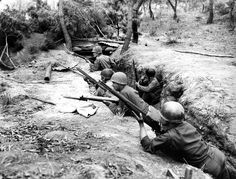 Korean War American soldiers in the trenches, Korea, 1950. Courtesy Everett/CSU Archives