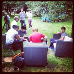 Ed hanging with One direction while being filmed.