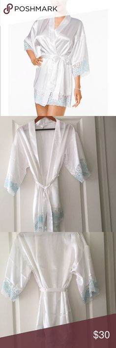 NWOT Flora by Flora Nikrooz Robe NWOT Flora by Flora Nikrooz Adore Charmeuse and Lace Kimono Robe ❤ Brand New without tags. Wore for 15 minutes to take pictures for a wedding. Had to take off tag for pictures. Did not wear longer than 15 minutes and wore over clothes. Feels nice against skin and looks great ❤ white Robe work blue lace trim. Would be perfect for a bride or for anyone to wear around the house. Flora Nikrooz Intimates & Sleepwear Robes