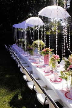 .I love the hanging umbrellas! and the draping sparkle looks like water or rain.