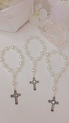 Items similar to DOZEN Beautiful glass pearl Rosary bracelets. Perfect for first communions, and wedding favors. First Communion Party, Communion Favors, Baptism Favors, Baptism Party, First Holy Communion, Beaded Jewelry, Beaded Bracelets, Rosary Bracelet, Christening
