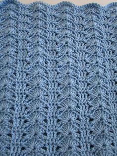 The Arching Shell Crochet Blanket produces a very sophisticated and stylish blanket. It is an easy pattern that produces impressive results. Make