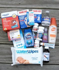 different kinds of bandages, instant ice packs, eye drops, cortisone cream, Benadryl, Emetrol, hand sanitizer and hand sanitizing wipes, a small bottle of water, children's and adult's acetaminophen, children's and adult's ibuprofen, antacids, antibiotic ointment, insect repellent, baby wipes