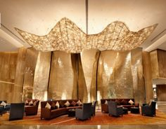 Glitz and Glam! The golden glow of the lobby in the Hilton Guangzhou Tianhe in China.