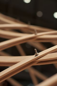 """woven wooden grid shel. The result of a """"4-day workshop at SmartGeometry 2012 focused on the design and construction of a wooden gridshell using only straight wood members bent along geodesic lines on a relaxed surface."""""""