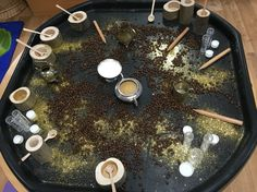 Sensory/messy play potion making with coffee beans and glitter. Builders tray activity for Reception Class. EYFS