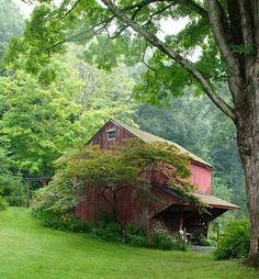 .red barn on hillside.