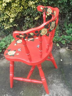 Red wooden chair with hand painted roses and butterflies