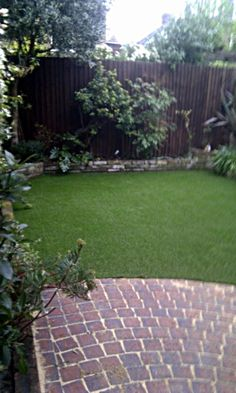 artifical-lawn-brick-patio-london-stock-raised-beds-mixed-planting-blahm-clapham-london.jpg