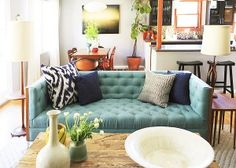 Funky living room- i love that couch!
