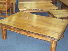 yellowood coffee tables with sneezewood side trim …