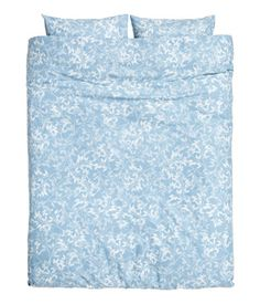 Light blue. King/queen duvet cover set in cotton fabric with a printed pattern. Duvet cover fastens at foot end with concealed metal snap fasteners. Two