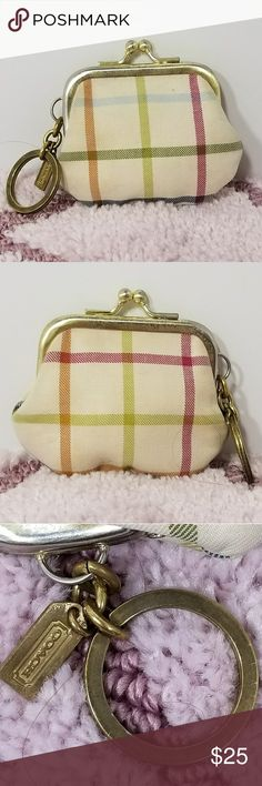 COACH Tattersall Striped Kiss Lock Coin Purse Brand:  Coach  Item: *Tattersall Triped Change Purse *It is Very Light Beige with Large Stripes All Around  *It has a Kisslock Closure *Interior is Blue Satin Feeling Lining *It Has a Roud Key Holder *Small Coach Hang Tag on the Keychain *There is one tiny 'dot' of a stain on the Upper Right - It Can Be Seen on the First Pic *All though this piece is in excellent condition - I do have to add that there is some very light tarnish on the metal…