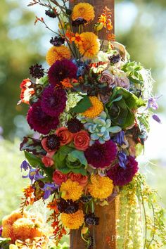 organic floral arrangements with vegetables, dahlias, purple, orange, succulents