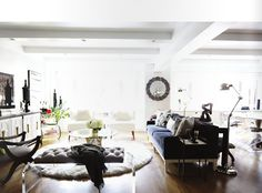 6 Ideas For Decorating a One-Bedroom // living room, open plan, tufted bench, armchair, sofa, modern