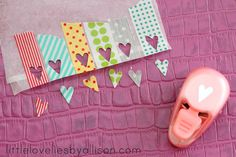 tutorial by Allison Maestri: washi tape stickers. As well as the hearts you could use the left over tape with the heart negatives too.