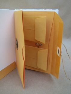 For storing things in the back of journals, scrapbooks, etc by Katherine Gray