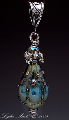 dragon egg |  Lydia Muell © 2011 - I like the embellishments used to make it a pendant.
