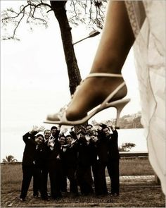 Bride and Groomsmen photo. I'd definitely do this!!