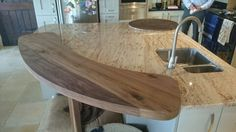 walnut curve 60mm to 30mm thick to sit over the granite island