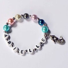 Love these!  Wish I could do this for all the girls who come to Anna's party! Pearl and Silver Little Mermaid Charm Bracelet Personalized Name Bracelet Child Jewelry Party Favor Infant Children Kid Toddler Adults. $4.00, via Etsy.
