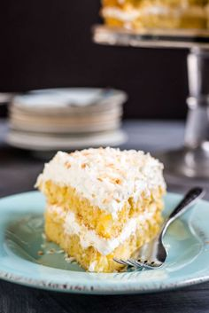 This Pineapple Coconut Cake is packed with fresh pineapple and piled high with a dreamy, fluffy whipped coconut frosting.