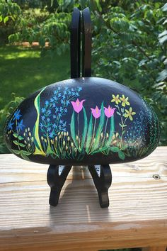 The design on the front and sides was added with acrylic paints prior to coating the finished stone multiple times with a clear UV-Resistant high-gloss sealant. Painted Rocks For Sale, Hand Painted Rocks, Unique Housewarming Gifts, River Stones, Rock Art, High Gloss, Etsy Store, House Warming, Flowers