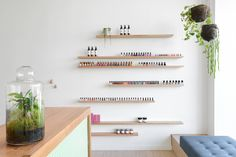 A toxic free, minimalist nail salon whose clean space reflects the company's natural philosophy with bamboo floors, a limited palette, and pebble tiles.