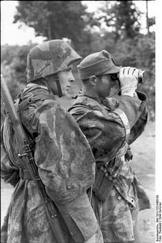 German soldiers (paratroopers or Waffen SS) obverving enemy. (Normandy 1944)
