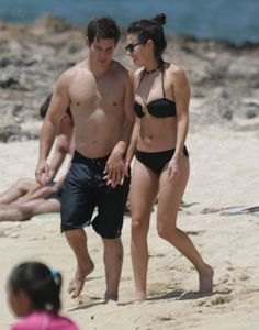 Pin for Later: You'll Need to Cool Off After Seeing These Sexy Celebrity Beach PDA Pictures  Adam DeVine and his girlfriend, actress Chloe Bridges, held hands as they walked along a beach in Oahu, Hawaii, in May 2015.