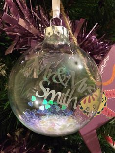 """Mr & Mrs Smith"" Papercut in a Christmas Tree Bauble. Papercut by Dala Designs Christmas Tree Baubles, Christmas Bulbs, Mr And Mrs Smith, Paper Cutting, Holiday Decor, Design, Home Decor, Decoration Home, Christmas Light Bulbs"