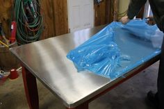 Sheet metal counters, table or island? VanHook & Co.: Topping a table with zinc sheet metal.