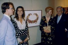 Paris, France, June 4, 1980 — Princess Grace during an exhibition of her dried flower collages, with her son, Prince Albert, her husband, Prince Rainier, and her eldest daughter, Princess Caroline.