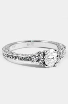 18K WHITE GOLD SET WITH 0.51 CARAT, OVAL