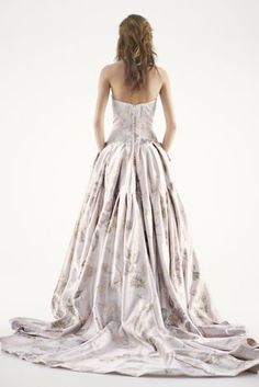 Metallic jacquard ball gown with drop waist and button-back detailing.  Features a breathtaking cathedral train.