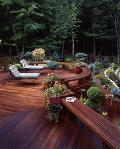 Rounded far end of floating deck with built in seats.  30 Wooden Benches That Increase the Welcome of Your Garden | DesignRulz