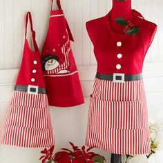Holiday Candy Stripe Santa Apron - cotton bib apron with pockets;Applique belt with dimensional flocked faux buttons Link Christmas Aprons, Christmas Sewing, Sewing Aprons, Sewing Clothes, Cool Aprons, Apron Designs, Holiday Candy, Bib Apron, Apron Pockets