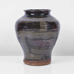 WILLIAM STAITE MURRAY Baluster Vase Stoneware, olive green over iron crackle glazes with geometric designs and iron red splashes, a pale blue flush at the shoulder, impressed M seal H 18.5cm, D 15.5cm