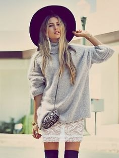 knit turtleneck over lace dress