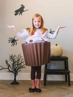An old laundry basket, wrapping paper, felt and basic craft supplies are all you need to dress your little sweetie up as their favorite icing-and-sprinkle-topped treat.