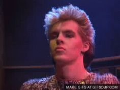 Even though he is wearing that fluffy pullover sweater, Nick Rhodes still judges your fashion sense.